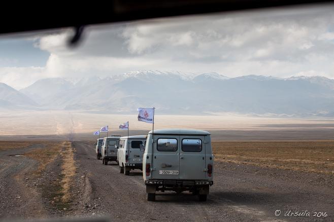 Four UAZs driving towards the Altai Mountains, Mongolia