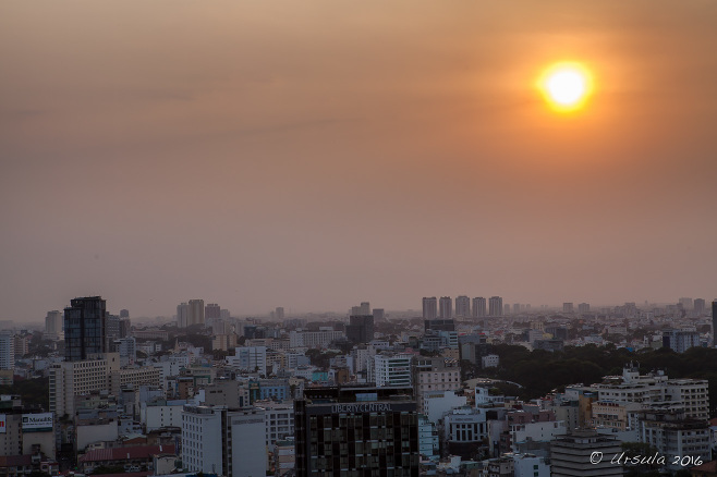 View over Ho Chi Minh from the rooftop bar at Sheraton Saigon Hotel as the sun sets, Vietnam