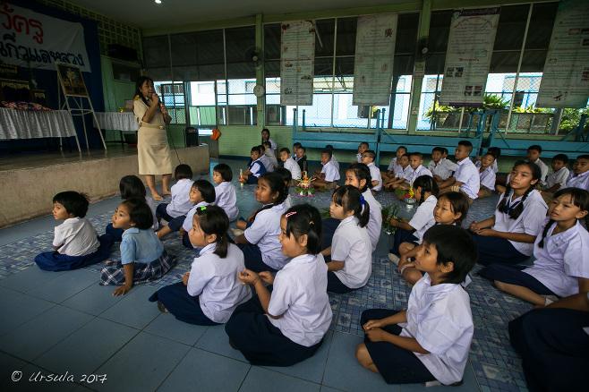 Thai school children sitting on a school auditorium floor, Chiang Mai Thailand