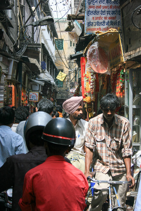 Indian people in a Crowded Laneway, Chandni Chowk Street, Old Delhi, India.
