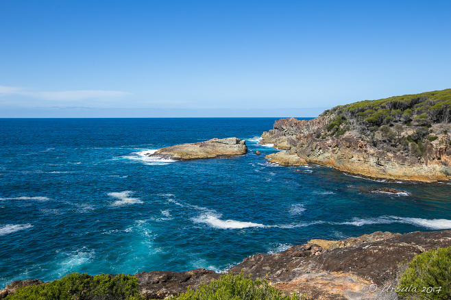 View over the coastline from above Rocky Beach, Bournda National Park, NSW AU
