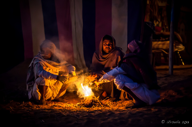 Indian men around a camp fire in the dark, Rajasthan