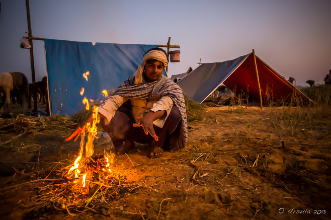 Indian man around a camp fire in the dark, Rajasthan