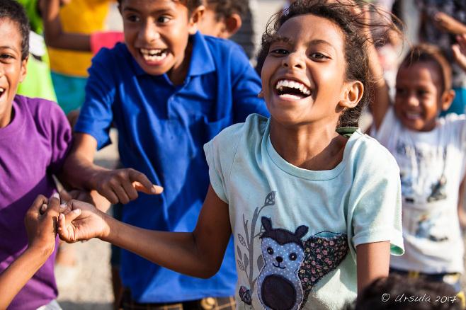 Over-excited Motu children, Hanuabada Village, Papua New Guinea