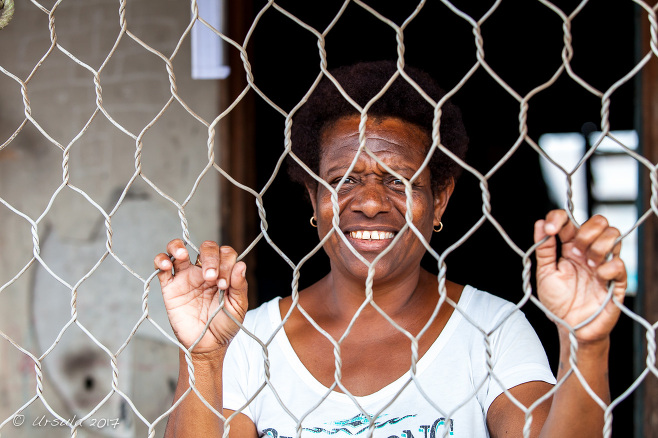 Motu Woman behind a wire fence, Hanuabada Village, Papua New Guinea