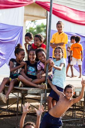 ver-excited Motu children, Hanuabada Village, Papua New Guinea