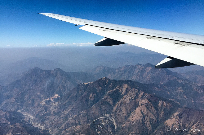 Airplane wing over the Kathmandu Valley, Nepal