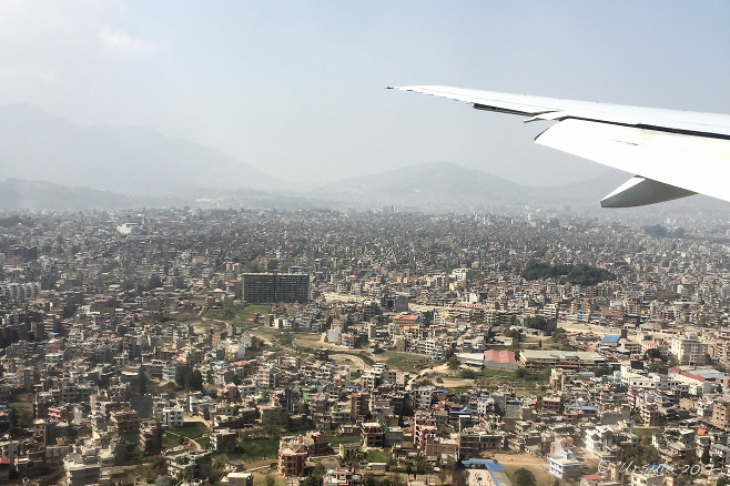 Airplane wing over Kathmandu, Nepal