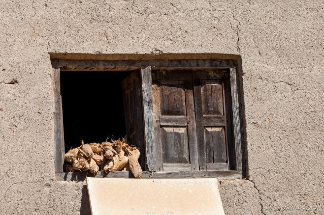 Corn drying in a wooden-framed window, Panauti-Namobuddha Rd, Nepal