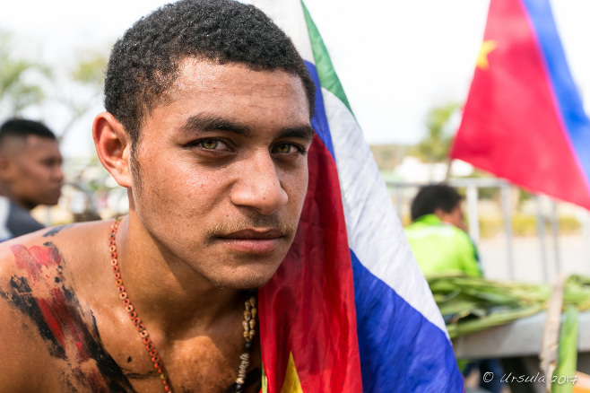 Portrait: Young Papuan man with a flag,, Port Moresby, Papua New Guinea