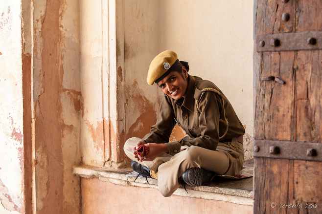 Seated Indian woman in a uniform, Amer Fort, Rajasthan